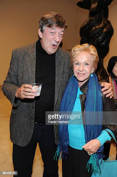 Actor Stephen Fry and Pat York photographer pose at the Black Totem Series Artist Reception held at Ace Gallery on February 4 2010 in Beverly Hills...