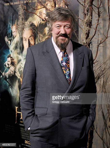 Actor Stephen Fry arrives at the Los Angeles premiere of The Hobbit The Desolation Of Smaug at TCL Chinese Theatre on December 2 2013 in Hollywood...