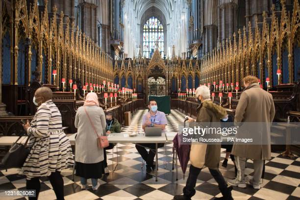 Actor Stephen Fry is given an injection of the Covid-19 vaccine at a new vaccination site at Poets' Corner in Westminster Abbey, London.
