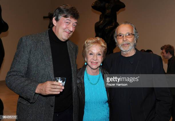 Actor Stephen Fry Pat York and Herb Alpert artist pose at the Black Totem Series Artist Reception held at Ace Gallery on February 4 2010 in Beverly...