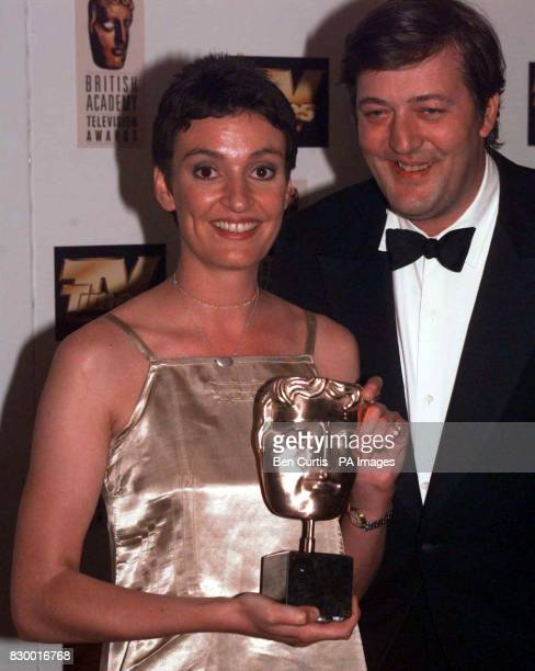 Actor Stephen Fry with Daniela Nardini from BBC 2's London based soap 'This Life' after presenting her with the 'Best Actress' Award at the BAFTA TV...