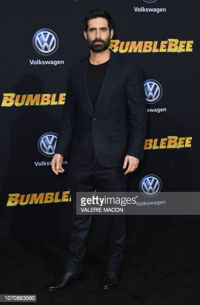 """Actor Stephen Schneider attends the global premiere of """"Bumblebee"""" at the TCL Chinese theatre in Hollywood on December 9, 2018."""
