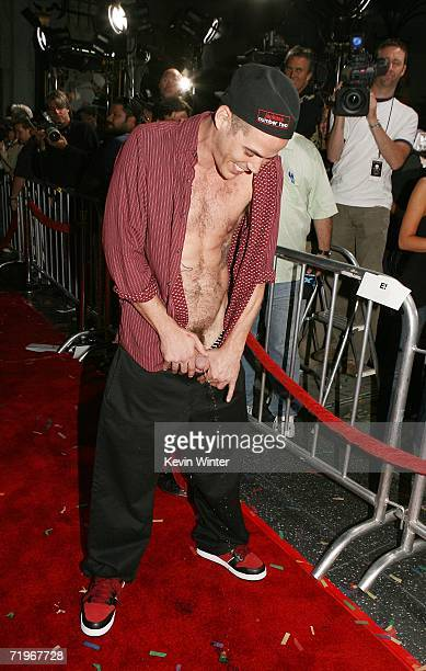 Actor Stephen 'SteveO' Glover urinates on the red carpet at the premiere of Paramount's 'Jackass Number Two' at the Chinese Theater on September 21...