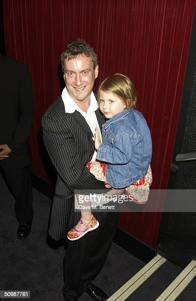 Actor Stephen Tompkinson carries his daughter Daisy as they attend the afterparty following the UK Premiere of the classical novel by Jules Verne...