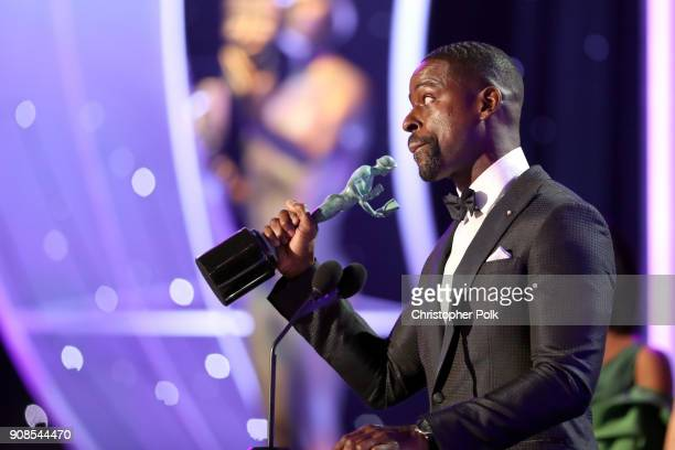 Actor Sterling K Brown accepts the Outstanding Performance by a Male Actor in a Drama Series award onstage during the 24th Annual Screen Actors Guild...