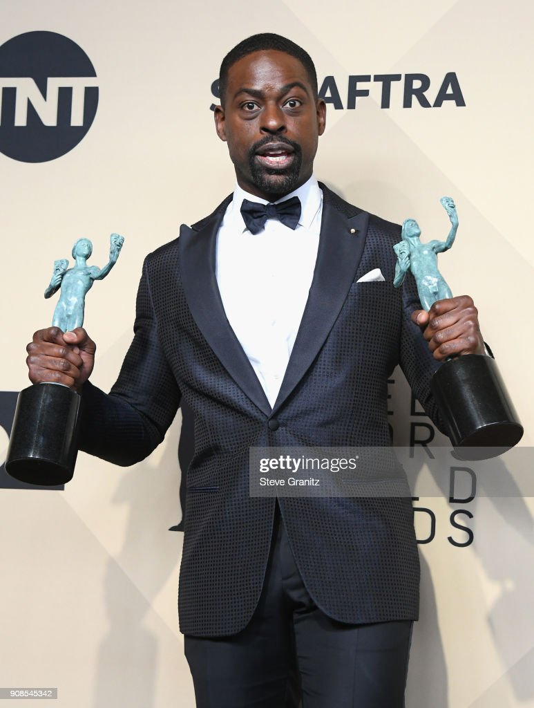 Actor Sterling K. Brown, winner of the awards for Outstanding Performance by a Male Actor in a Drama Series and Outstanding Performance by an Ensemble in a Drama Series for 'This Is Us,' poses in the press room during the 24th Annual Screen Actors Guild Awards at The Shrine Auditorium on January 21, 2018 in Los Angeles, California.