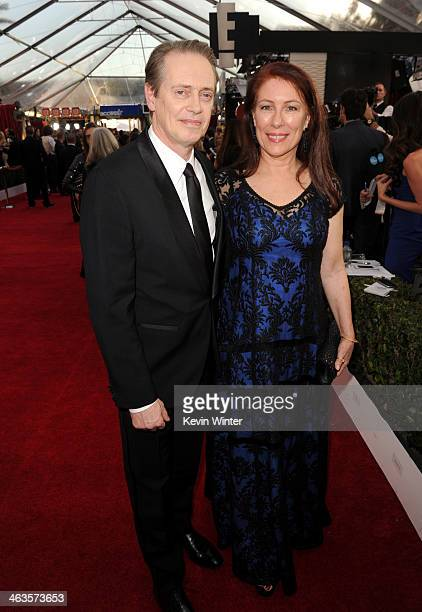 Actor Steve Buscemi and actress Jo Andres attend 20th Annual Screen Actors Guild Awards at The Shrine Auditorium on January 18 2014 in Los Angeles...