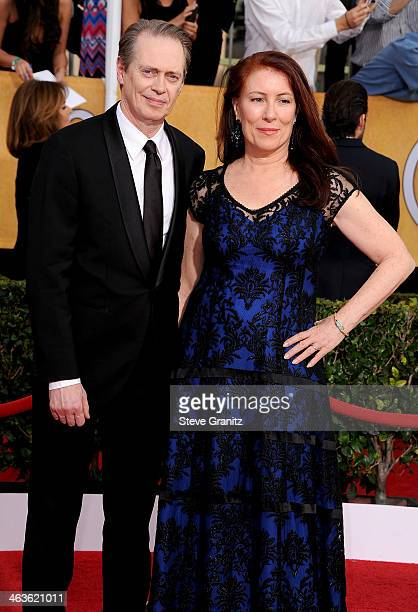 Actor Steve Buscemi and director Jo Andres attend the 20th Annual Screen Actors Guild Awards at The Shrine Auditorium on January 18 2014 in Los...