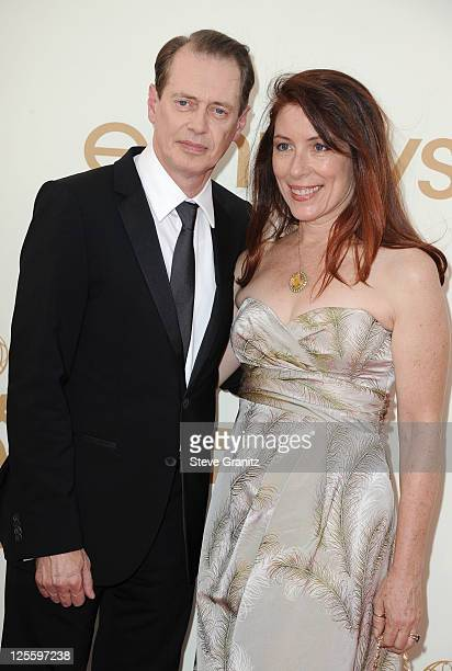 Actor Steve Buscemi and Jo Andres arrive to the 63rd Primetime Emmy Awards at the Nokia Theatre LA Live on September 18 2011 in Los Angeles United...
