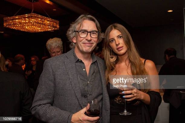 Actor Steve Coogan and guest pose for a photo at the Sony Pictures Classics TIFF Celebration Dinner at Morton's on September 8, 2018 in Toronto,...