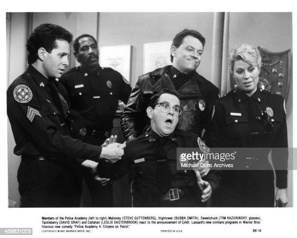 """Actor Steve Guttenberg, Bubba Smith, Tim Kazurinsky, David Graf and actress Leslie Easterbrook on set of the movie """"Police Academy 4: Citizens on..."""
