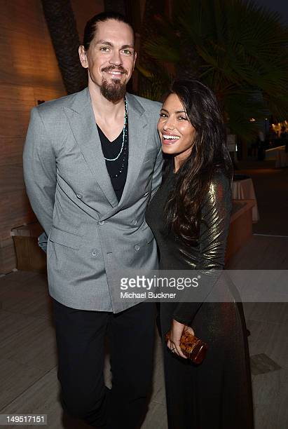 Actor Steve Howey and actress Sarah Shahi attend Oceana's SeaChange Summer Party at a private residence on July 29 2012 in Laguna Beach California