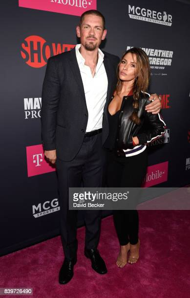 Actor Steve Howey and Sarah Shahi arrive on TMobile's magenta carpet duirng the Showtime WME IME and Mayweather Promotions VIP PreFight Party for...