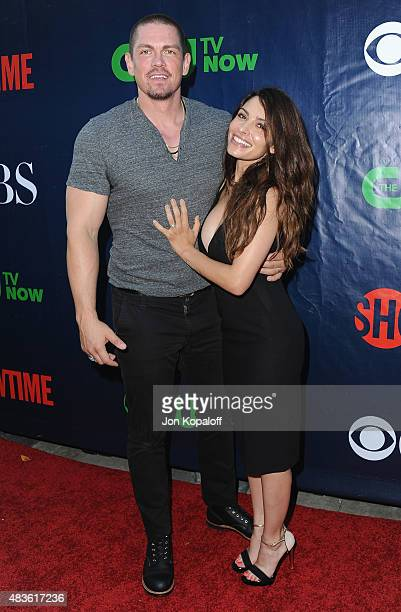 Actor Steve Howey and wife actress Sarah Shahi arrive at CBS CW And Showtime 2015 Summer TCA Party at Pacific Design Center on August 10 2015 in West...
