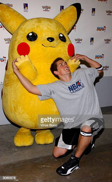 Actor Steve Howey poses with Pikachu at the Frankie Muniz HoopLA celebrity charity basketball game presented by Pokemon Trading Card Games on March...