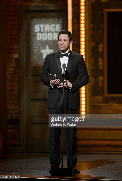 Actor Steve Kazee accepts the award for Best Performance by a Leading Actor in a Musical for 'Once' onstage at the 66th Annual Tony Awards at The...