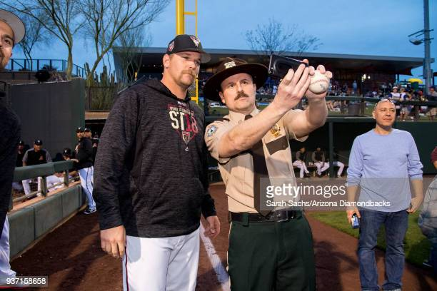 Actor Steve Lemme takes a selfie with Arizona Diamondbacks pitcher Andrew Chafin at Salt River Fields at Talking Stick on March 22 2018 in Scottsdale...