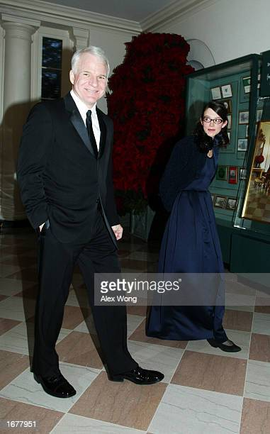 Actor Steve Martin arrives for a reception of the 2002 Kennedy Center Honors with his guest Anne Stringfield December 8, 2002 at the White House in...