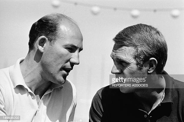 Actor Steve Mcqueen with racing driver Stirling Moss at the Monaco Grand Prix on May 31 1965 in Monaco