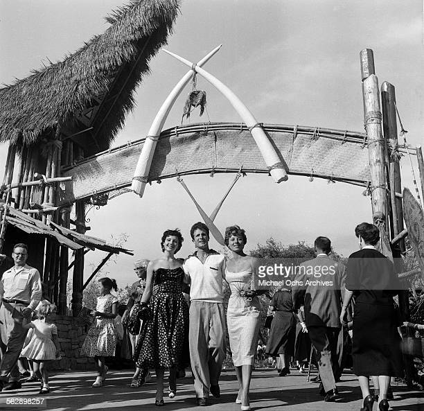 Actor Steve Rowland and actress Kathleen Case and Adelle August pose as they walk through the park during the Opening day of Disneyland in...