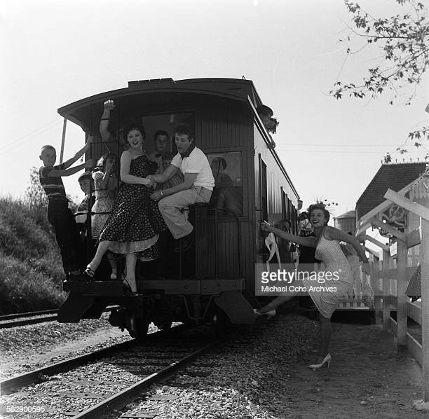 Actor Steve Rowland and actress Kathleen Case and Adelle August pose on the train during the Opening day of Disneyland in AnaheimCalifornia