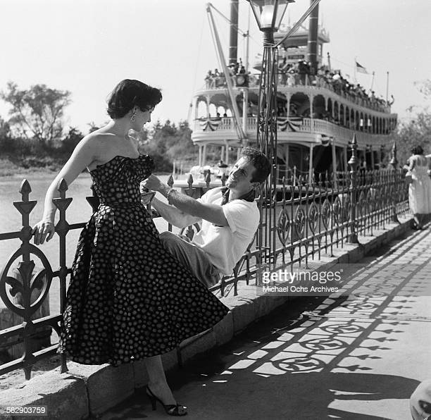 Actor Steve Rowland and actress Kathleen Case pose by the Mark Twain Riverboat during the Opening day of Disneyland in AnaheimCalifornia
