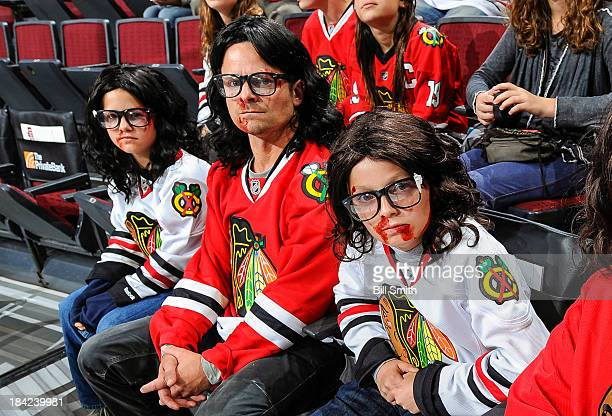 Actor Steve Zahn and his two children Audrey Clair Zahn and Henry James Zahn watch the NHL game between the Buffalo Sabres and the Chicago Blackhawks...