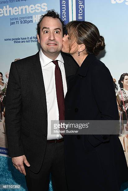 """Actor Steve Zissis and actress Amanda Peet attend the premiere of HBO's """"Togetherness"""" at Avalon on January 6, 2015 in Hollywood, California."""