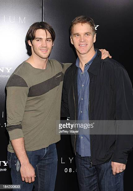 Actor Steven R McQueen and former NHL player Luc Robitaille arrive at the Los Angeles premiere of 'Elysium' at Regency Village Theatre on August 7...