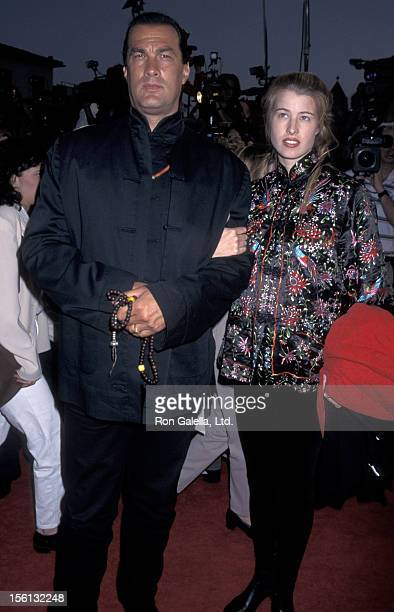 Actor Steven Seagal and Arissa Wolf attending the world premiere of 'Twister' on May 8 1996 at Mann Village Theater in Westwood California
