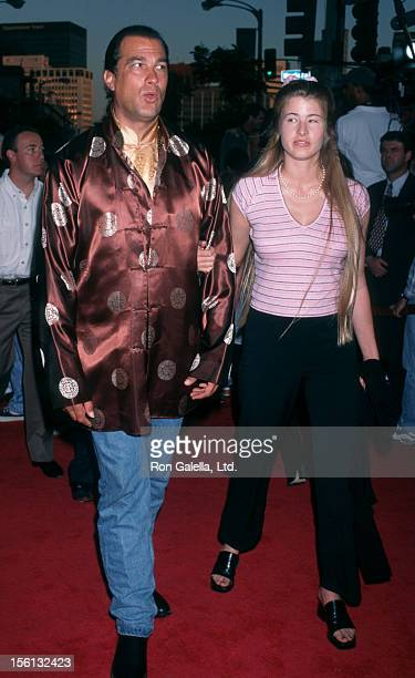 Actor Steven Seagal and Arissa Wolf attending the world premiere of 'Conspiracy Theory' on August 4 1997 at Mann Village Theater in Westwood...