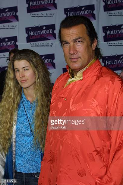 Actor Steven Seagal and wife Adrienne La Russa arrive at the Hard Rock Charity Jam for Hollywoodcharitiesorg August 29 2001 in Universal City CA
