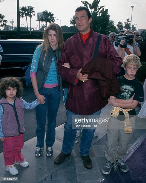 Actor Steven Seagal Arissa Wolf and children attending the premiere of 'Snow Day' on January 29 2000 at the Paramount Thater in Hollywood California