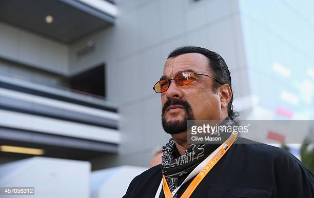 Actor Steven Seagal attends qualifying ahead of the Russian Formula One Grand Prix at Sochi Autodrom on October 11 2014 in Sochi Russia