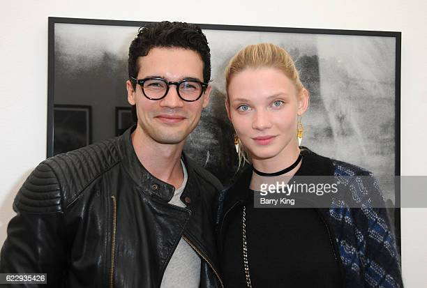 Actor Steven Strait and Dario Zhemkova attend 'Hindsight Is 30/40 A Group Photographer Exhibition' at The Salon at Automatic Sweat on November 12...