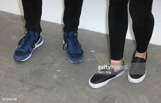 Actor Steven Strait and Dario Zhemkova shoe detail attend 'Hindsight Is 30/40 A Group Photographer Exhibition' at The Salon at Automatic Sweat on...