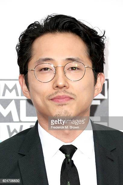 Actor Steven Yeun attends the 2016 American Music Awards at Microsoft Theater on November 20 2016 in Los Angeles California
