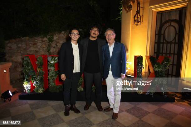 Actor Steven Yeun director Bong JoonHo and actor Byung Heebong attend the Netflix party during the 70th annual Cannes Film Festival at on May 21 2017...