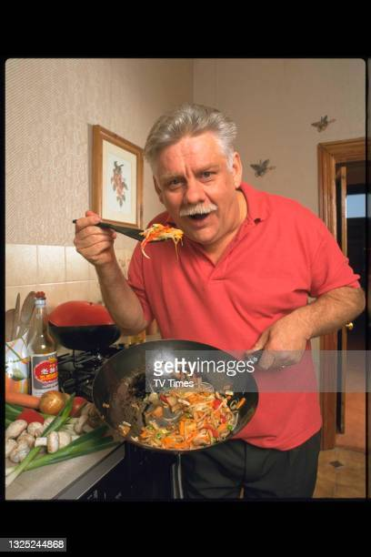 Actor Stuart Golland, best known for his role as George Ward in drama series Heartbeat, photographed cooking at home, circa December 1996.