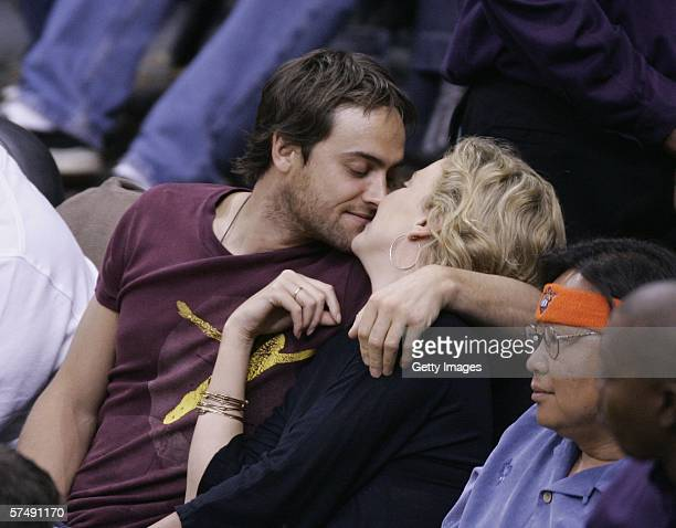 Actor Stuart Townsend and actress Charlize Theron attend the Los Angeles LakersPhoenix Suns playoff game on April 28 2006 at Staples Center in Los...