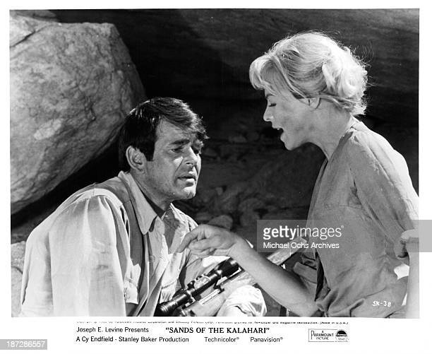 Actor Stuart Whitman and actress Susannah York on set of Paramount Pictures movie Sands of the Kalahari in 1965