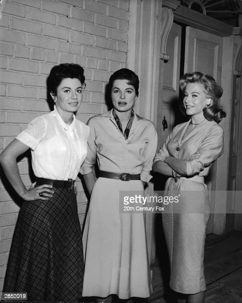 Actor Sue Carson actor Linda Hutchings and American actor and model June Blair pose on the set of 'The Best Of Everything' directed by Jean Negulesco...