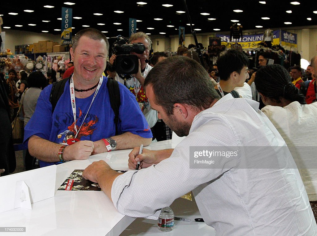 Actor Sullivan Stapleton (R) attends Cinemax's 'Strike Back' cast autograph signing at San Diego Convention Center on July 19, 2013 in San Diego, California.