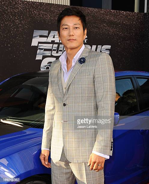 """Actor Sung Kang attends the premiere of """"Fast & Furious 6"""" at Universal CityWalk on May 21, 2013 in Universal City, California."""