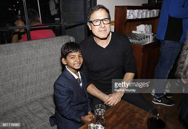 Actor Sunny Pawar and David O'Russell attend a special screening and reception of LION hosted by David O'Russell and Lee Daniels celebrating director...