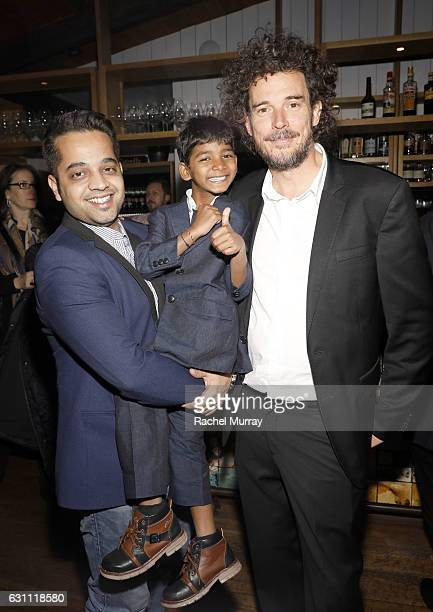 Actor Sunny Pawar and LION Director Garth Davis attend a special screening and reception of LION hosted by David O'Russell and Lee Daniels...