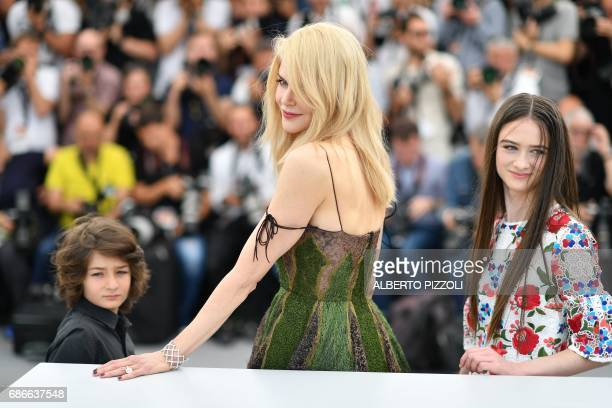 US actor Sunny Suljic Australian actress Nicole Kidman and British actress Raffey Cassidy pose on May 22 2017 during a photocall for the film 'The...