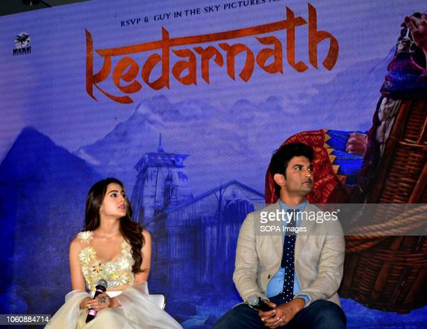 Actor Sushant Singh Rajput and Sara Ali Khan pose for photos on the trailer launch of their upcoming film Kedarnath at hotel JW Marriott Juhu in...
