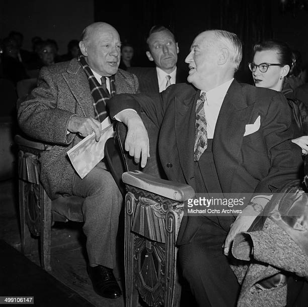 Actor Sydney Greenstreet attends a premiere as he talks to actor Edmund Gwenn in Los Angeles California