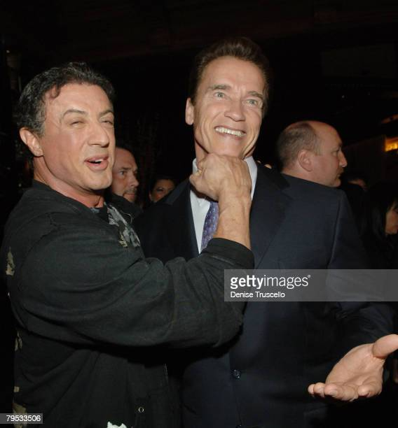 Actor Sylvester Stallone and California governor Arnold Schwarzenegger pose for photos at the prered carpet cocktail party for the world premiere of...